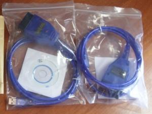 На фото - кабель с CD-диском для прошивки ЭБУ ВАЗ, drive2.ru
